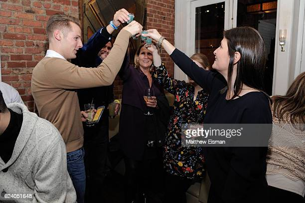 """Director Lara Stolman , swimmer Tom Luchsinger and guests toast at the afterparty for the New York premiere of """"Swim Team"""" at DOC NYC on November 17,..."""