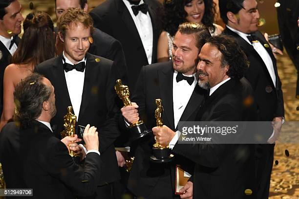 Director Laszlo Nemes , winner of Best Foreign Language Film for 'Son of Saul,' looks on as cinematographer Emmanuel Lubezki , winner of Best...