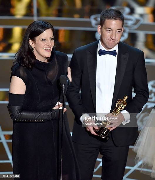 """Director Laura Poitras and journalist Glenn Greenwald accept Best Documentary Feature Award for """"Citizenfour"""" onstage during the 87th Annual Academy..."""