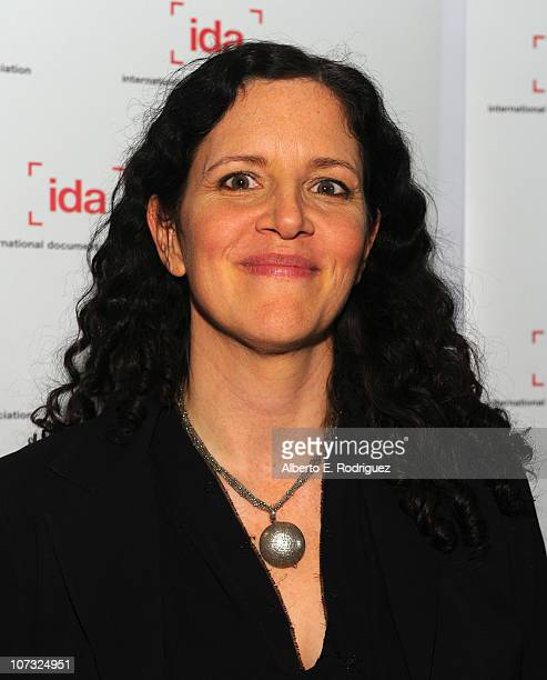 Director Laura Poitras arrives at the International Documentary Association's 26th annual awards ceremony at the Directors Guild Of America on...