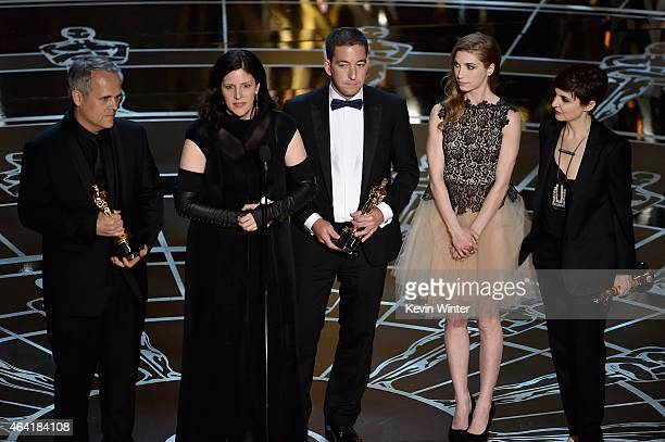 """Director Laura Poitras, Dirk Wilutzky, Lindsay Mills and journalist Glenn Greenwald accept Best Documentary Feature Award for """"Citizenfour"""" onstage..."""