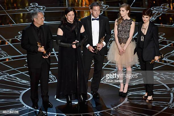 Director Laura Poitras Dirk Wilutzky Lindsay Mills and journalist Glenn Greenwald accept Best Documentary Feature Award for Citizenfour onstage...