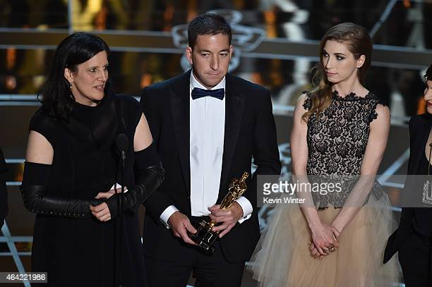 Director Laura Poitras journalist Glenn Greenwald and Lindsay Mills accept Best Documentary Feature for 'Citizenfour' onstage during the 87th Annual...