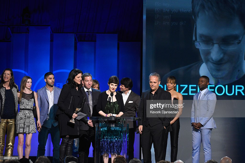 Director Laura Poitras, journalist Glenn Greenwald, producer Mathilde Bonnefoy and crew accept Best Documentary for 'Citizenfour' from actors Carmen Ejogo and David Oyelowo onstage during the 2015 Film Independent Spirit Awards at Santa Monica Beach on February 21, 2015 in Santa Monica, California.