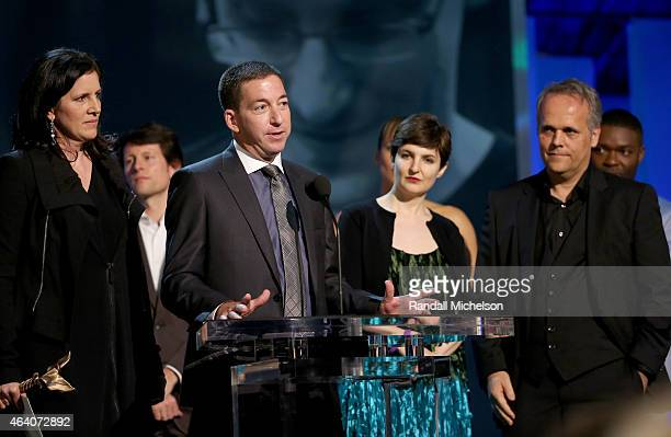 Director Laura Poitras lawyer Glenn Greenwald producers Mathilde Bonnefoy and Dirk Wilutzky accept Best Documentary award for 'Citizenfour' onstage...