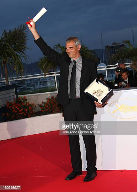 Director Laurent Cantet winner of the Palme d'Or Award for the film 'Entre Les Murs' poses at the Palme d'Or closing ceremony photocall at the Palais...