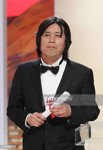 Director Lee Changdong poses after winning the Best Screenplay award for 'Poetry' during the Palme d'Or Award Ceremony held at the Palais des...
