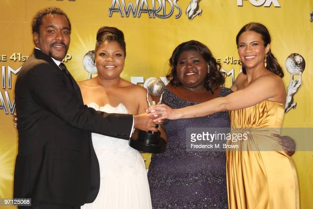 Director Lee Daniels actresses Mo'Nique Gabourey Sidibe and Paula Patton pose in the press room with the award for Outstanding Motion Picture for...