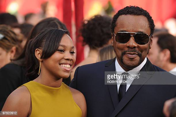 Director Lee Daniels and his daughter Clara arrive at the 82nd Academy Awards at the Kodak Theater in Hollywood California on March 07 2010 AFP PHOTO...