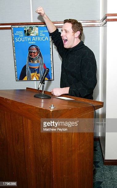 Director Lee Hirsch yells AMANDLA during the New York premiere of Artisan's Amandla A Revolution In Four Part Harmony at South African Consulate on...
