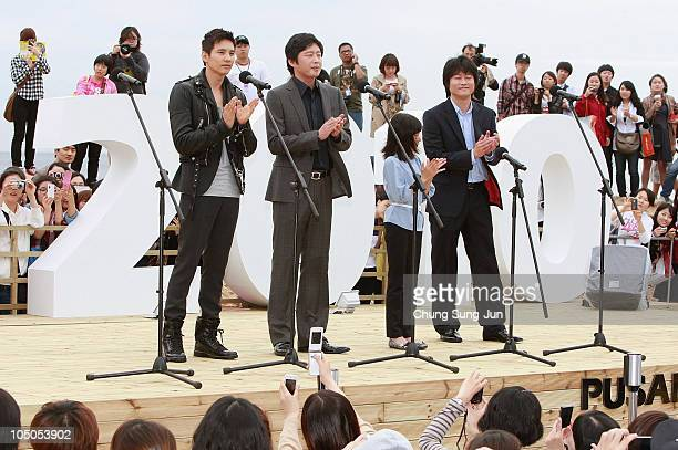 Director Lee JeongBeom actress Kim SaeRon and actor Won Bin applause at a meet and greet for 'The Man from Nowhere' during the 15th Pusan...