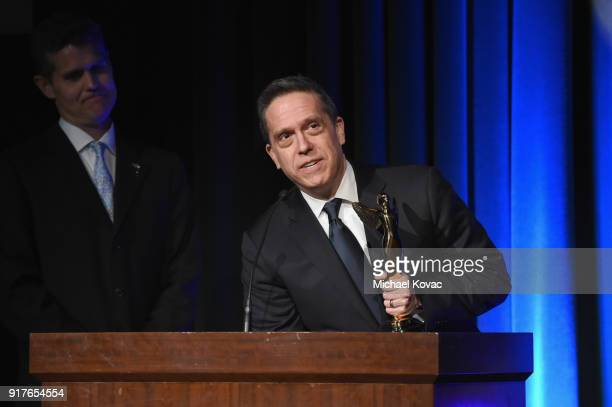 Director Lee Unkrich accepts the Lumiere Award for Best 3D Animated Feature onstage at the the Advanced Imaging Society 2018 Lumiere Awards presented...