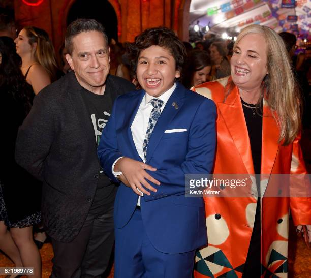 Director Lee Unkrich actor Anthony Gonzalez and producer Darla K Anderson arrive at the premiere of Disney Pixar's 'Coco' at the El Capitan Theatre...