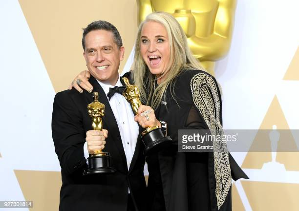 "Director Lee Unkrich and Producer Darla K Anderson winners of the Animated Feature award for ""Coco"" pose in the press room during the 90th Annual..."