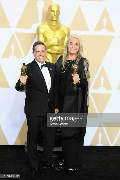 """Director Lee Unkrich and Producer Darla K Anderson winners of the Animated Feature award for """"Coco"""" pose in the press room during the 90th Annual..."""