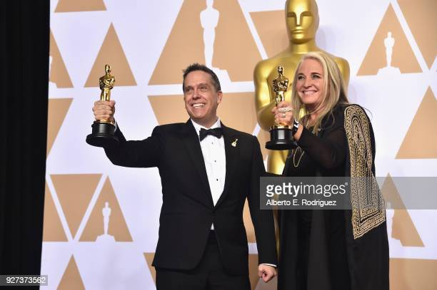 Director Lee Unkrich and producer Darla K Anderson winners of the Animated Feature award for 'Coco' pose in the press room during the 90th Annual...