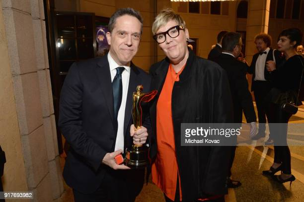 Director Lee Unkrich and producer Kori Rae pose with the Lumiere Award at the Advanced Imaging Society 2018 Lumiere Awards presented by Dell and...