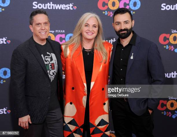 Director Lee Unkrich producer Darla K Anderson and codirector/screenwriter Adrian Molina arrive at the premiere of Disney Pixar's Coco at El Capitan...