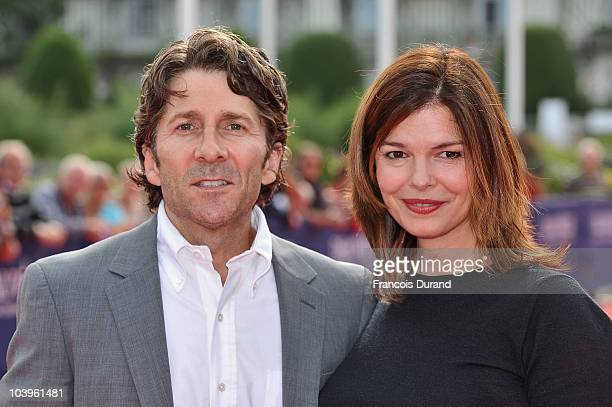 Director Leland Orser and actress Jeanne Tripplehorn arrive to attend the premiere of the film 'Morning' during the 36th Deauville American Film...