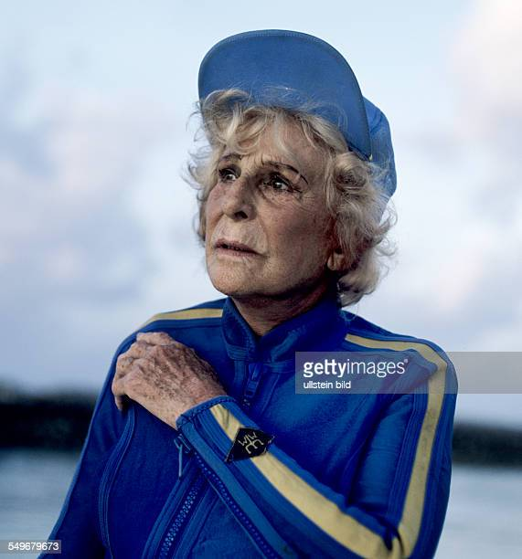 Director Leni Riefenstahl in a blue diving suit diving excursion in Maldives