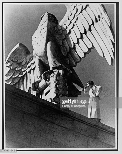 Director Leni Riefenstahl stands next to a large stone eagle at a stadium in Nuremberg during the filming of Triumph of the Will at the 1934 Nazi...