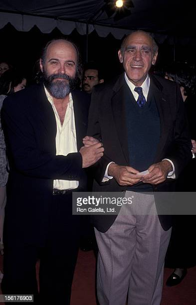 Director Leon Ichaso and actor Abe Vigoda attend the screening of 'Sugar Hill' on February 24 1994 at Mann Chinese Theater in Hollywood California