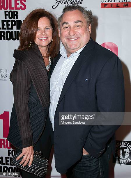 Director Leslie Greif and wife attend the Los Angeles Premiere of 10 Rules For Sleeping Around at the Egyptian Theatre on April 1 2014 in Hollywood...