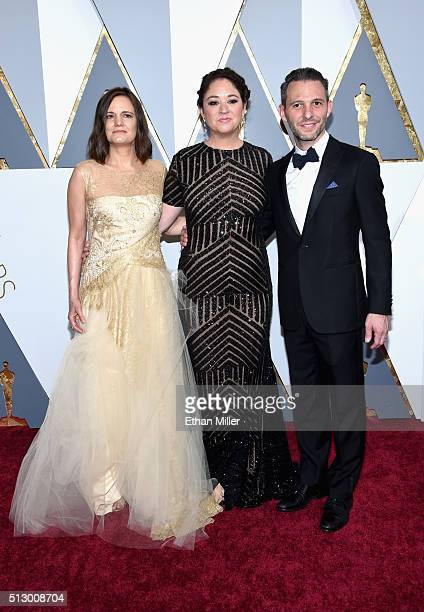 Director Liz Garbus producers Amy Hobby and Justin Wilkes attend the 88th Annual Academy Awards at Hollywood Highland Center on February 28 2016 in...
