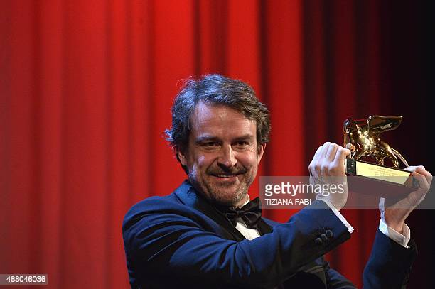 Director Lorenzo Vigas holds the Golden Lion for Best Film for his movie 'Desde Alla' during the awards ceremony on the closing day of the 72nd...