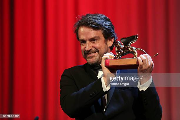 Director Lorenzo Vigas on stage with the Golden Lion Award for Best Film for 'From Afar' at the closing ceremony during the 72nd Venice Film Festival...