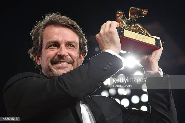 Director Lorenzo Vigas poses with the Golden Lion for Best Film for his movie 'Desde Alla' after the awards ceremony on the closing day of the 72nd...
