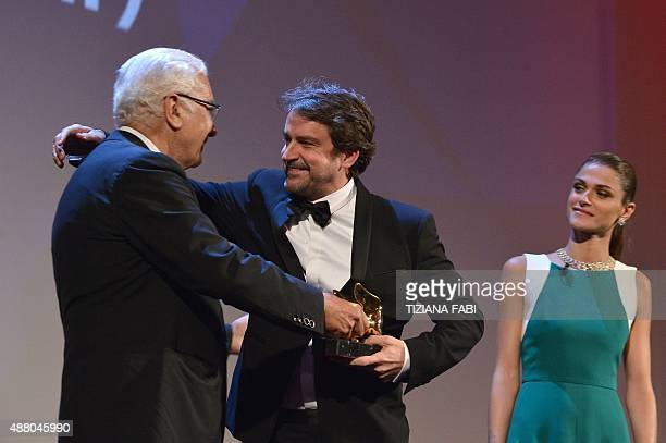 Director Lorenzo Vigas receives the Golden Lion for Best Film for his movie 'Desde Alla' from Venice Biennale president Paolo Baratta as Italian...