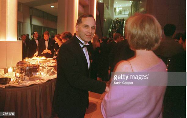 Director Louis Freeh takes his wife Marilyn's hand at a party for George Bush Sr. On the eve of inauguration in Washington, D.C., January 19, 2001.