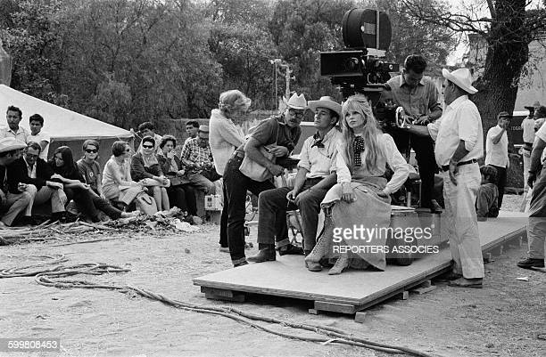Director Louis Malle And Brigitte Bardot Seated Under the Camera On The Set of the Movie 'Viva Maria' in Mexico on February 13 1965