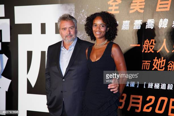 Director Luc Besson and his wife/producer Virginie Silla attend film 'Lucy' Taipei premiere on August 18 2014 in Taipei Taiwan