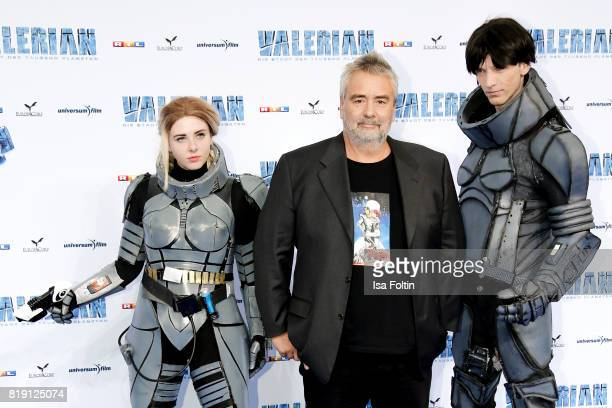 Director Luc Besson with film figures during the 'Valerian Die Stadt der Tausend Planeten' premiere at CineStar on July 19 2017 in Berlin Germany