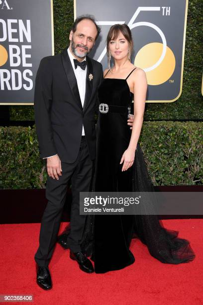 Director Luca Guadagnino and actor Dakota Johnson attend The 75th Annual Golden Globe Awards at The Beverly Hilton Hotel on January 7 2018 in Beverly...