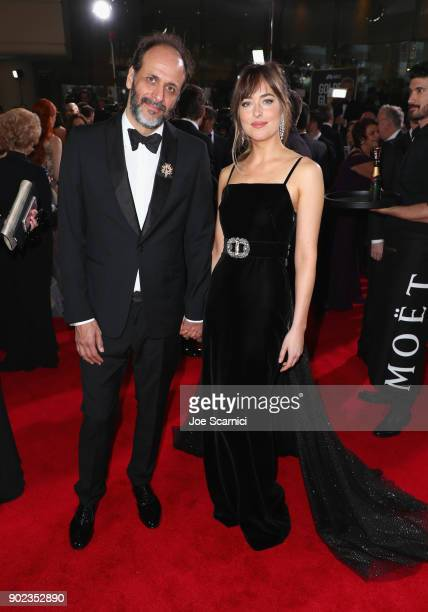 Director Luca Guadagnino and actor Dakota Johnson celebrate The 75th Annual Golden Globe Awards with Moet Chandon at The Beverly Hilton Hotel on...