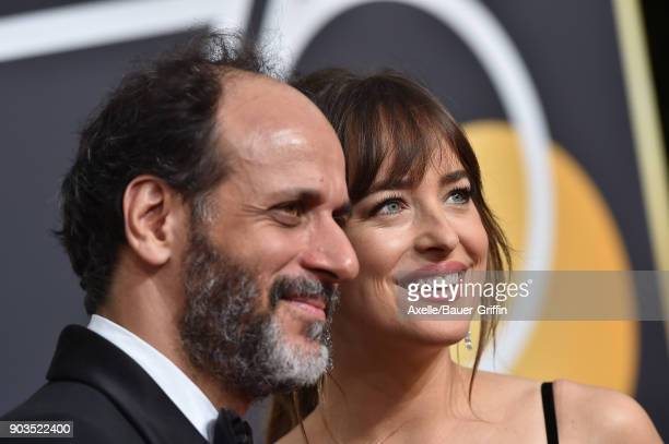 Director Luca Guadagnino and actress Dakota Johnson attend the 75th Annual Golden Globe Awards at The Beverly Hilton Hotel on January 7 2018 in...