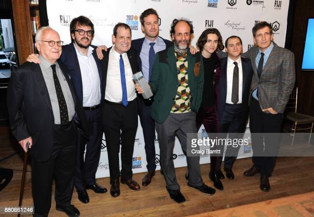 Director Luca Guadagnino poses with the cast of 'Call Me By Your Name' with their award for Best Feature Film at The 2017 IFP Gotham Independent Film...