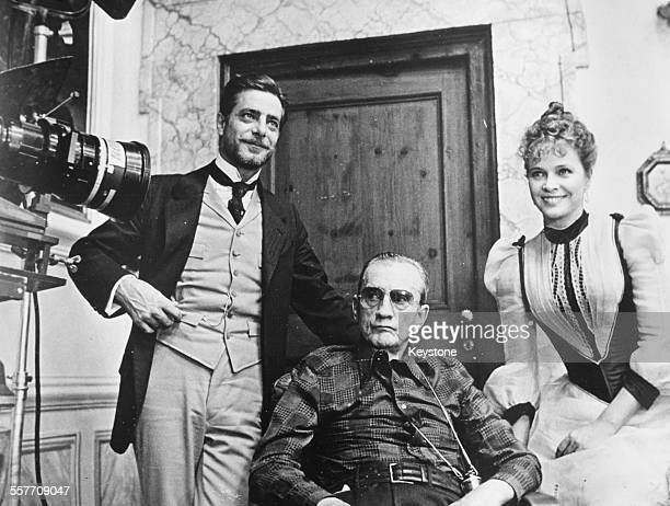 Director Luchino Visconti with actors Giancarlo Giannini and Laura Antonelli on the set of the film 'The Innocent' in Rome January 1976