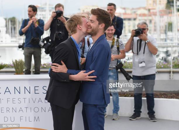 Director Lukas Dhont is greeted by actor Victor Polster attend the photocall for 'Girl' during the 71st annual Cannes Film Festival at Palais des...