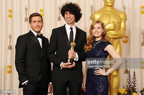 Director Luke Matheny , winner of the award for Best Live Action Short Film for 'God of Love', and presenters Jake Gyllenhaal and Amy Adams pose in...