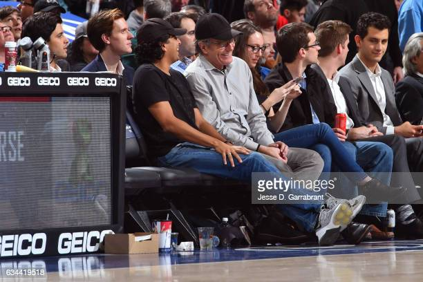 Director M Night Shyamalan and Actor Bryan Cranston attend the Philadelphia 76ers game against the San Antonio Spurs at Wells Fargo Center on...