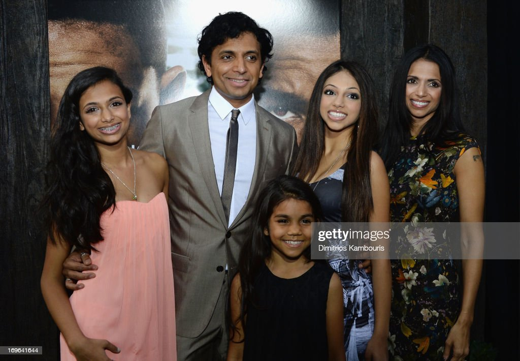 Director M. Night Shyamalan and Bhavna Vaswani (R) attend the 'After Earth' premiere at the Ziegfeld Theater on May 29, 2013 in New York City.