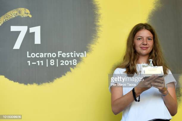 Director Magdalena Froger poses with Pardino D'Argento for Swiss Life for the National Competition at the Palmares photocall during the 71st Locarno...