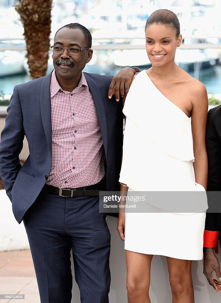 Director Mahamat Saleh Haroun and actress Anais Monory attend the photocall for 'Grigris' during The 66th Annual Cannes Film Festival on May 22, 2013 in Cannes, France.