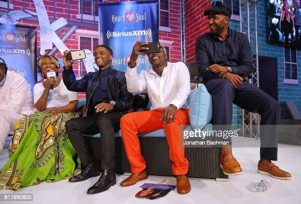Director Malcolm lee right producer Will Packer second from right and cast member Larenz Tate of the movie Girls Trip are interviewed by Michel...