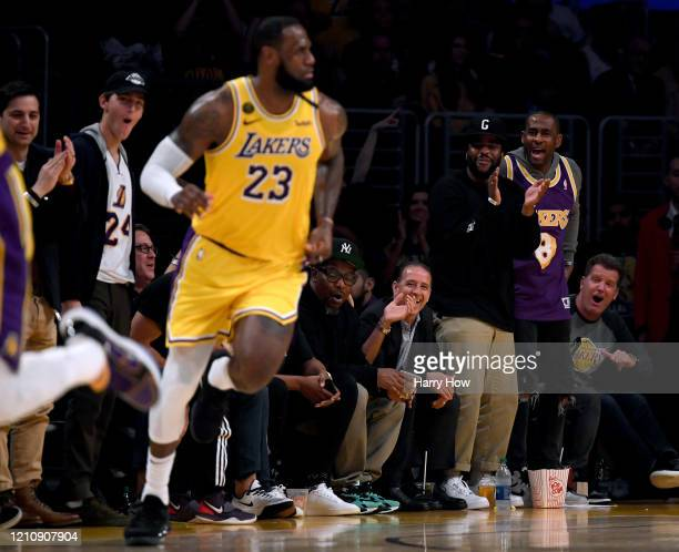 Director Malcolm Washington reacts after a basket by LeBron James of the Los Angeles Lakers during the game against the Milwaukee Bucks at Staples...