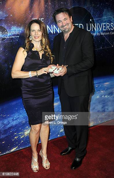 Director Malcom Carter and Dr Lesya Anna Adehl arrive for the Premiere Of 'The Connected Universe' at DGA Theater on September 26 2016 in Los Angeles...